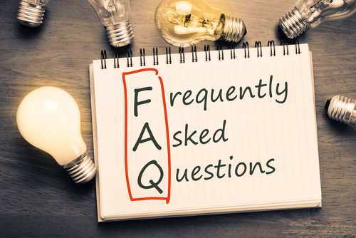 Note pad stating FAQ suronded by lightbulbs