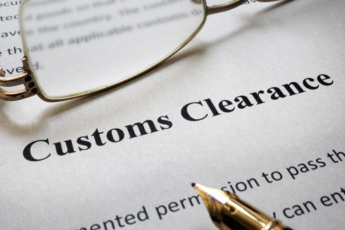 Customs Clearance print with glasses and a pen