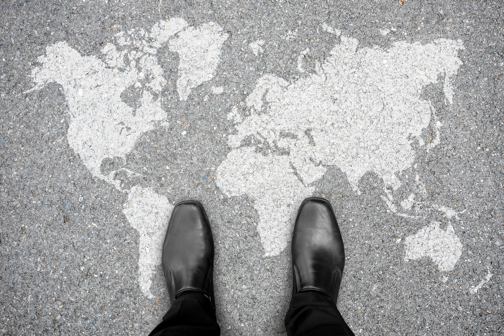 Man standing on globe painted on the ground