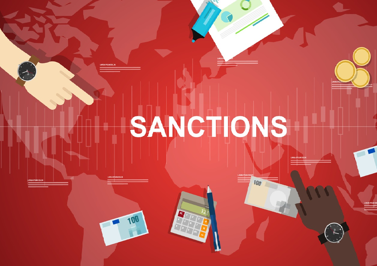 map of world with money and the words sanctions