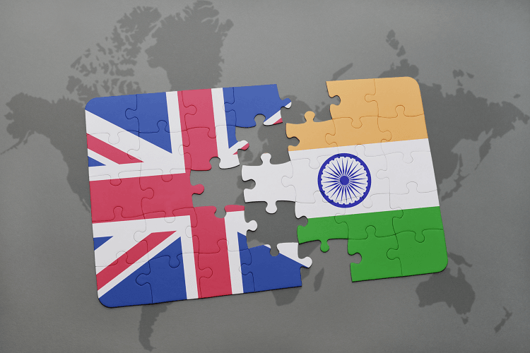 jigsaw puzzle with union jack and India flags