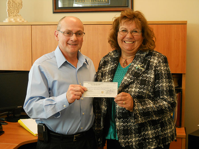 Peace River Local Council donation to Victim Services 2011