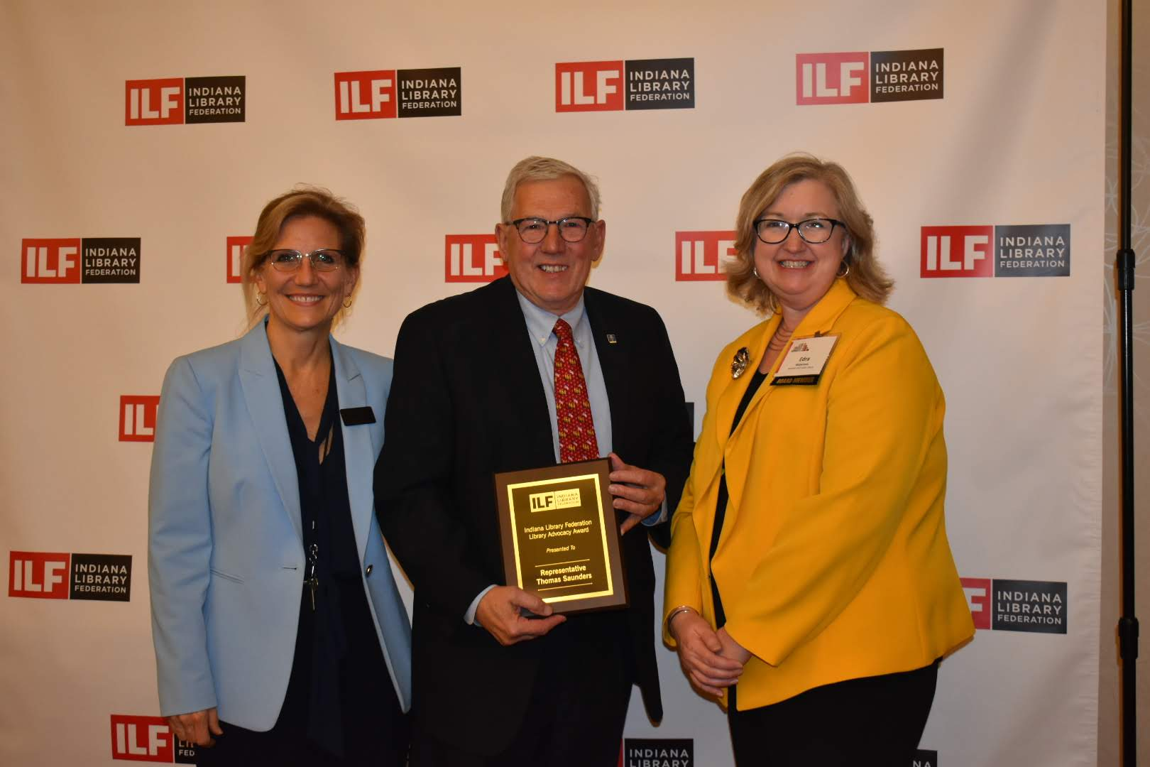 Rep. Tom Saunders with Lucinda Nord and Edra Waterman receiving ILF award