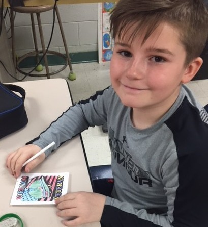 Centerville School student with card for veteran
