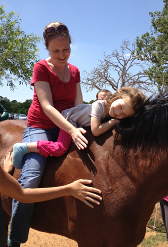 Mara and Mother on horse photo