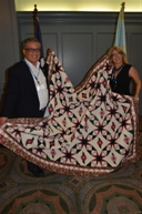 Diana Marie & Calvin Chow collect their winning quilt