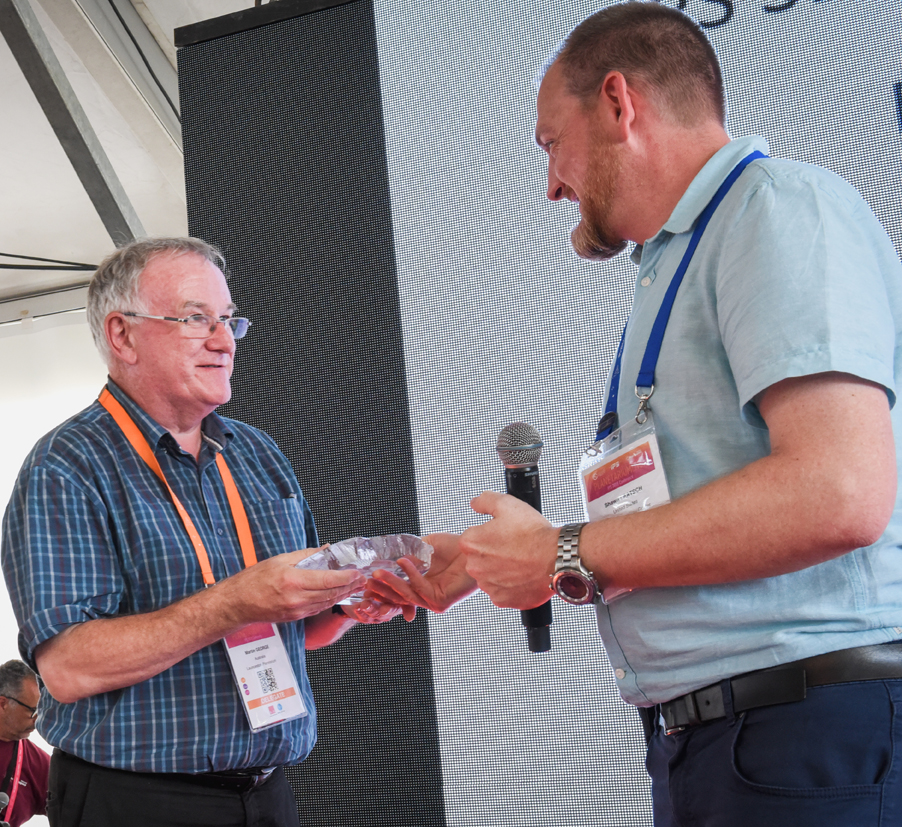 Martin George receives the service award from Shawn Laatsch