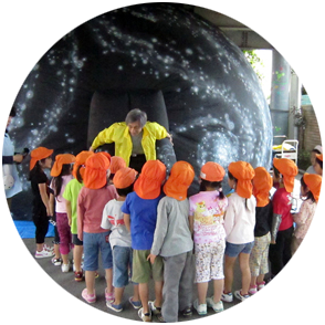 Image: Kindergarten students in Japan wait to visit a portable dome; photo provided by Hiroshi Futami