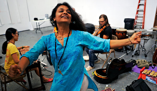 Aditi Bhagwat, an Indian foot percussionist, rehearsing with other OneBeat fellows, Kyungso Park, left, and Chance McCoy at Atlantic Center for the Arts, photo by David Manning