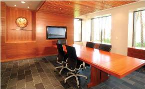 A wall of Lyptus wood and table of African mahogany complement each other beautifully in the main conference room of the Brookfield, Wisconsin law office.