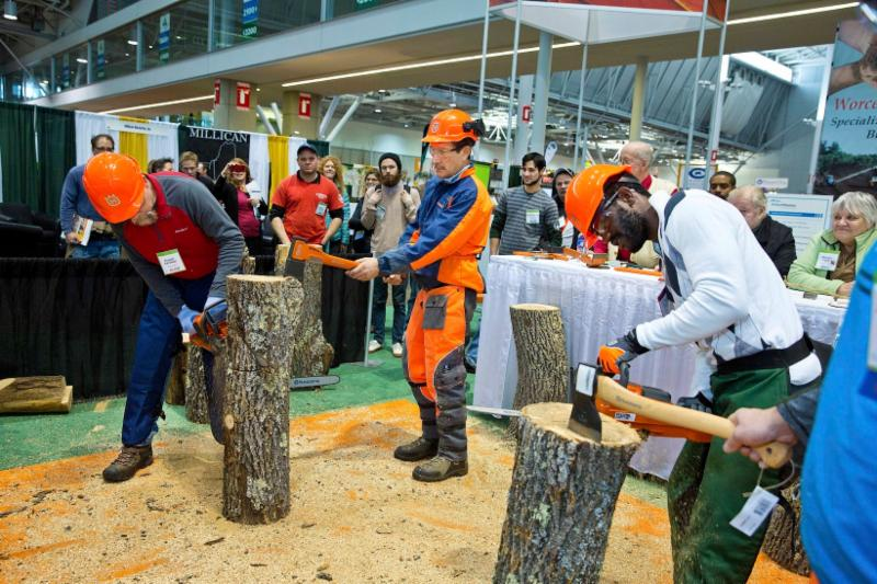 Arborists participate in a chain saw skills development competition at New England GROWS.