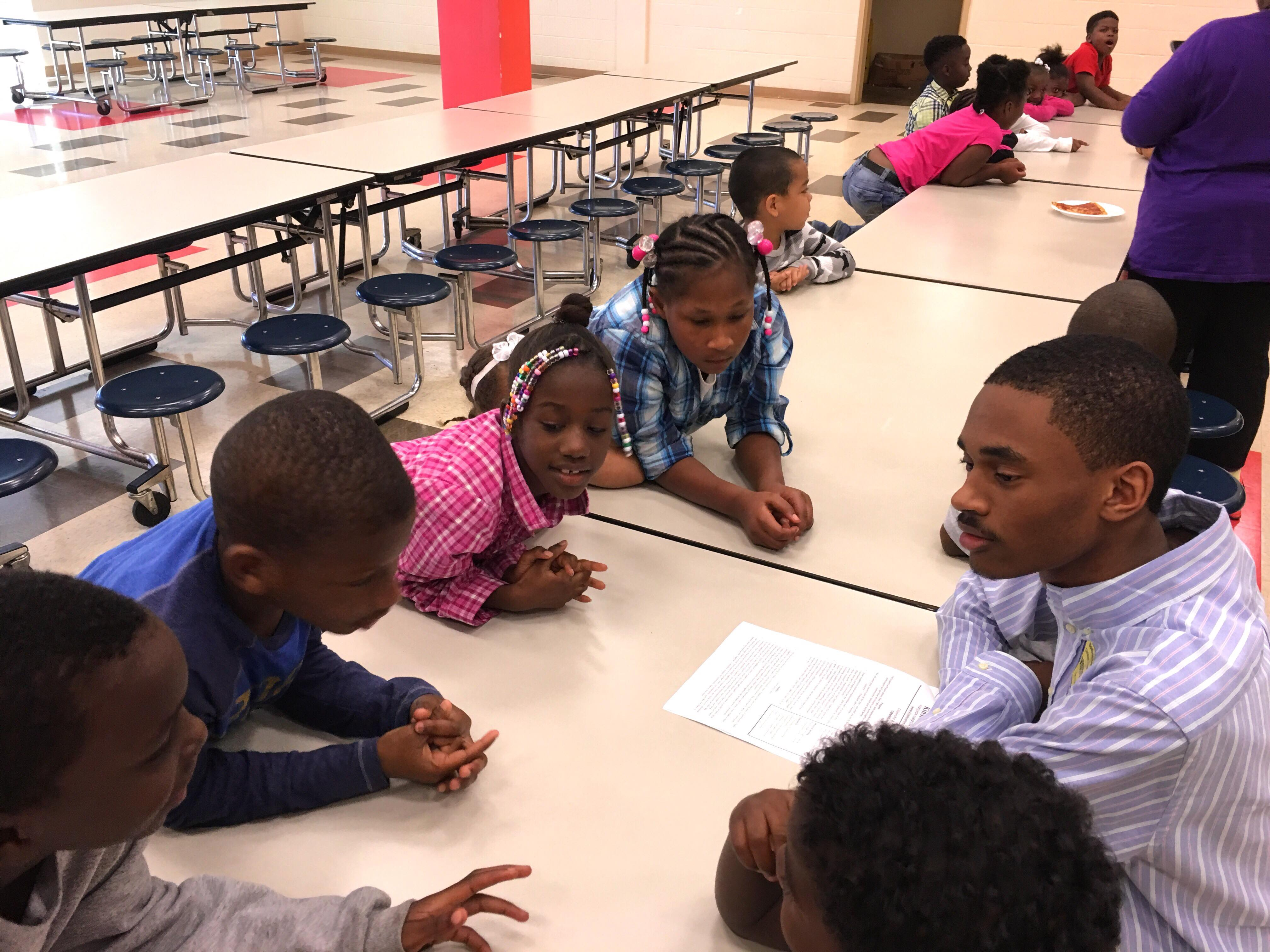 Chris J. Suggs spends time with the young people of Kinston, NC, as a part of his local mentorship program.