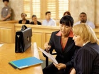 Women consulting in courtroom