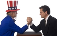 Uncle Sam and man in suit arm wrestling