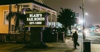 Sign on street reading Blair's Bail Bonds