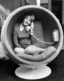 woman sitting in 1970s enclosed chair