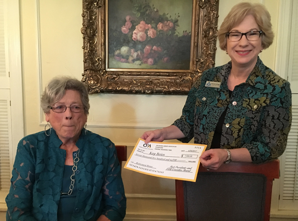 Kay receives her retirement check