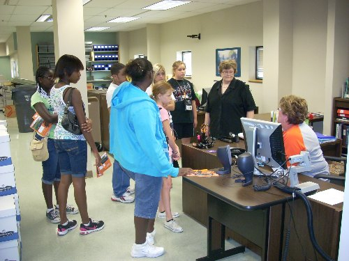 Beth Freeman takes the campers around OSU-Tulsa's Technical Services area