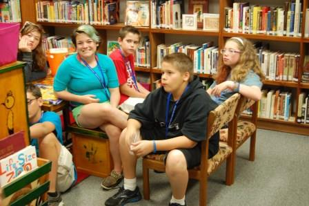 Campers visit a tribal library