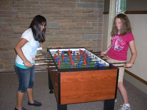 Campers playing foosball
