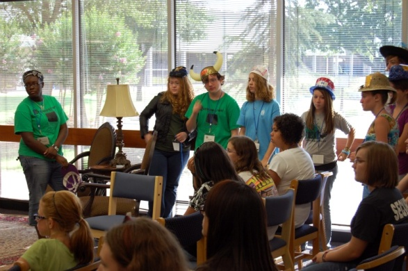 Campers wearing different librarian hats