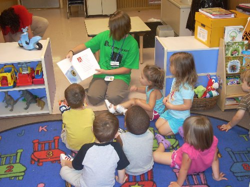 Reading to the kids at the TU Child Development Center