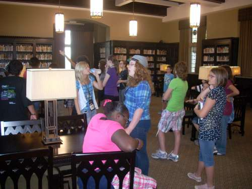 Campers admire the North Reading Room in McFarlin Library