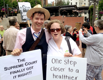 ONA Labor Representative, Rob Nosse, left, and ONA member, Jenny Taylor, RN, right, celebrate the Supreme Court ruling at a rally on June 28, 2012.