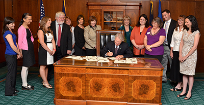 Governor Kitzhaber met with nursing leaders from across the state Monday, July 29, 2013, for a ceremonial bill signing of House Bill 2902. HB 2902 is the first law in the US to require insurance companies to reimburse primary care and mental health Nurse Practitioners, Physician Assistants and Physicians the same rates when they perform the same work and bill under the same codes.
