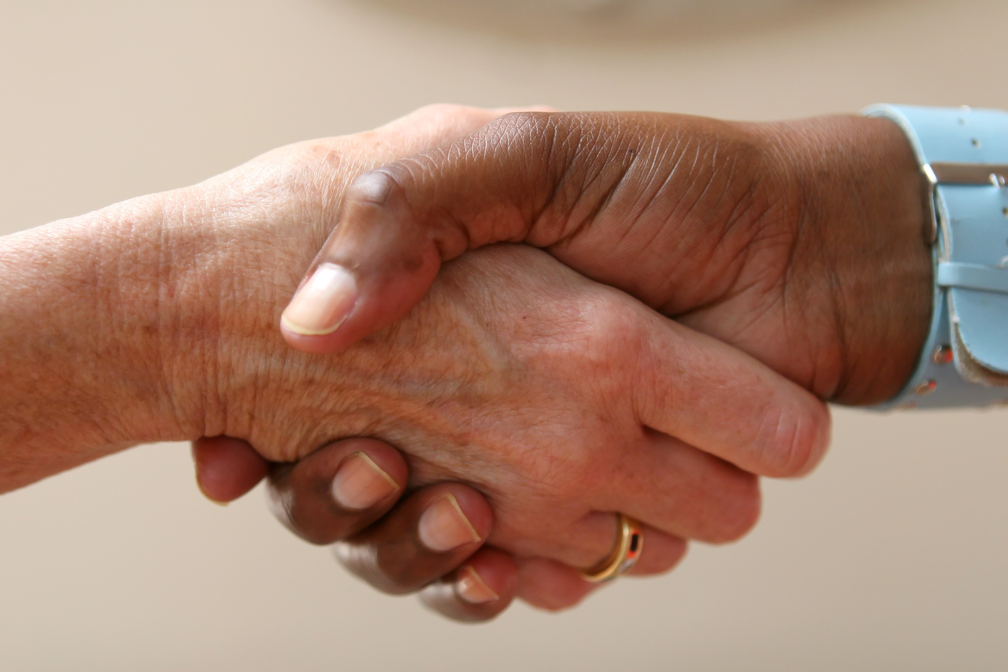 shaking hands in a gesture of help