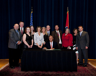 Front: Governor Bill Haslam; Back (L to R): Tim Brinegar (Dir. of Goverment Relations), Rep. Tony Shipley, Bethany Bowman (Dir. of Professional Development), Audrey Shores (Dir. of Technology & Communication), Rep. Terri Lynn Weaver, Cathy Kolb (PET Board President), Jan Forman (Dir. of Membership), J.C. Bowman (Executive Director), Rep. Debra Moody, Rep. Mary Littleton, Rep. William Lamberth