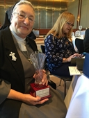 2017 Ameiricanism Award presented by Chapter 23 President Walt Wochos to Sr Ann Catherine Veierstahler for her volunteer work at the VA Hospital and with local veterans groups.