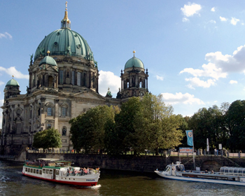 Image of the The Berliner Dom (Berlin Cathedral) and river with boats