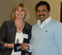 Barbara Schultz and Sanjeev Panicker sharing a smile as Sanjeev is recognized for earning his SPHR.