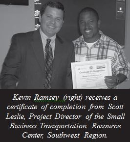 Kevin Ramsy receives certificate of completion from Scott Leslie