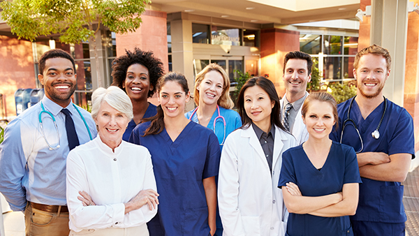 Group of workers in front of hospital