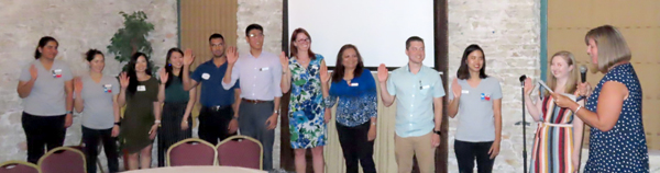 Incoming CAPA board members take the oath of office from TPA CEO Debbie Garza.