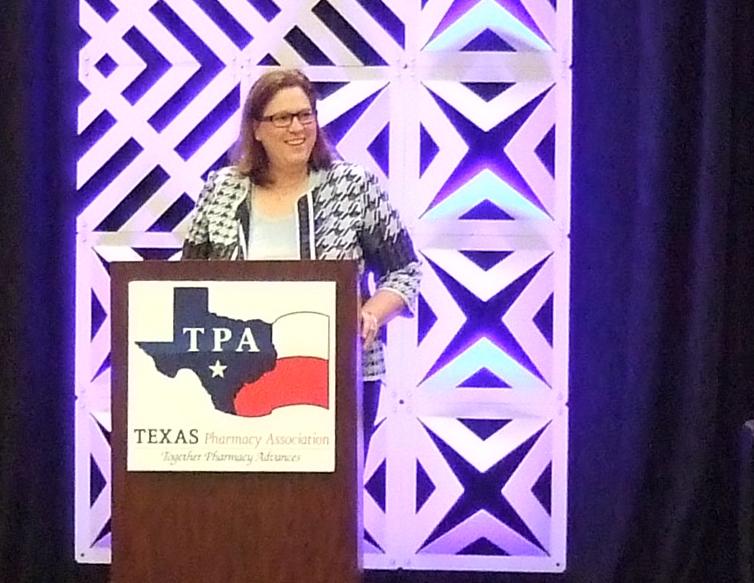 Rep. Julie Johnson addresses the 2019 PharmPAC Breakfast