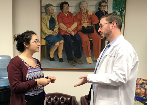 TPA Board Member Nathan Pope visits with a legislative staff member at the Capitol this week to discuss pharmacy-related legislation.