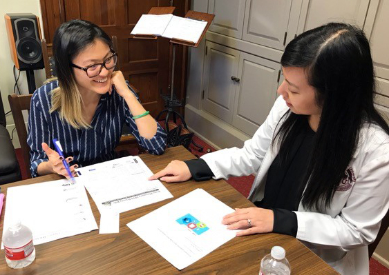 Mary Tran Young (right), TPA student pharmacist representative, explains pharmacy's policy priorities with a legislative staff member at the State Capitol.