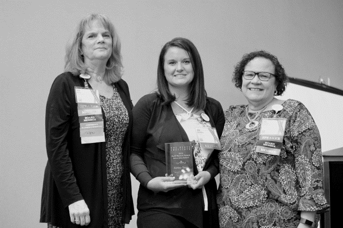 Ashley Doyle receiving the Ruth Ravich Patient Advocacy award at Patient Experience Conference 2019.