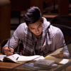Man Studies in Library. iStock Image; Copyright: OJO_Images
