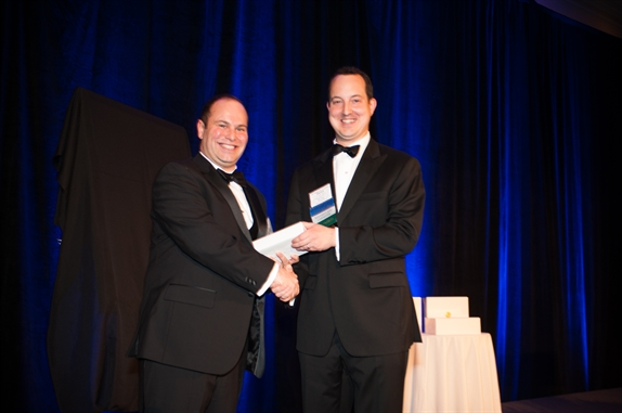 Seth Ragosta receives YLD Emerson G. Spies Award from YLD Chair Steven P. Gould