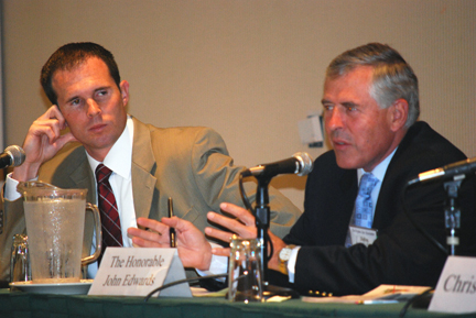 W. Ryan Snow considers comments by Virginia Senator John S. Edwards during CLE session on statutory changes and impacts on legal practices. The legislative update panel was presented in July 2011.
