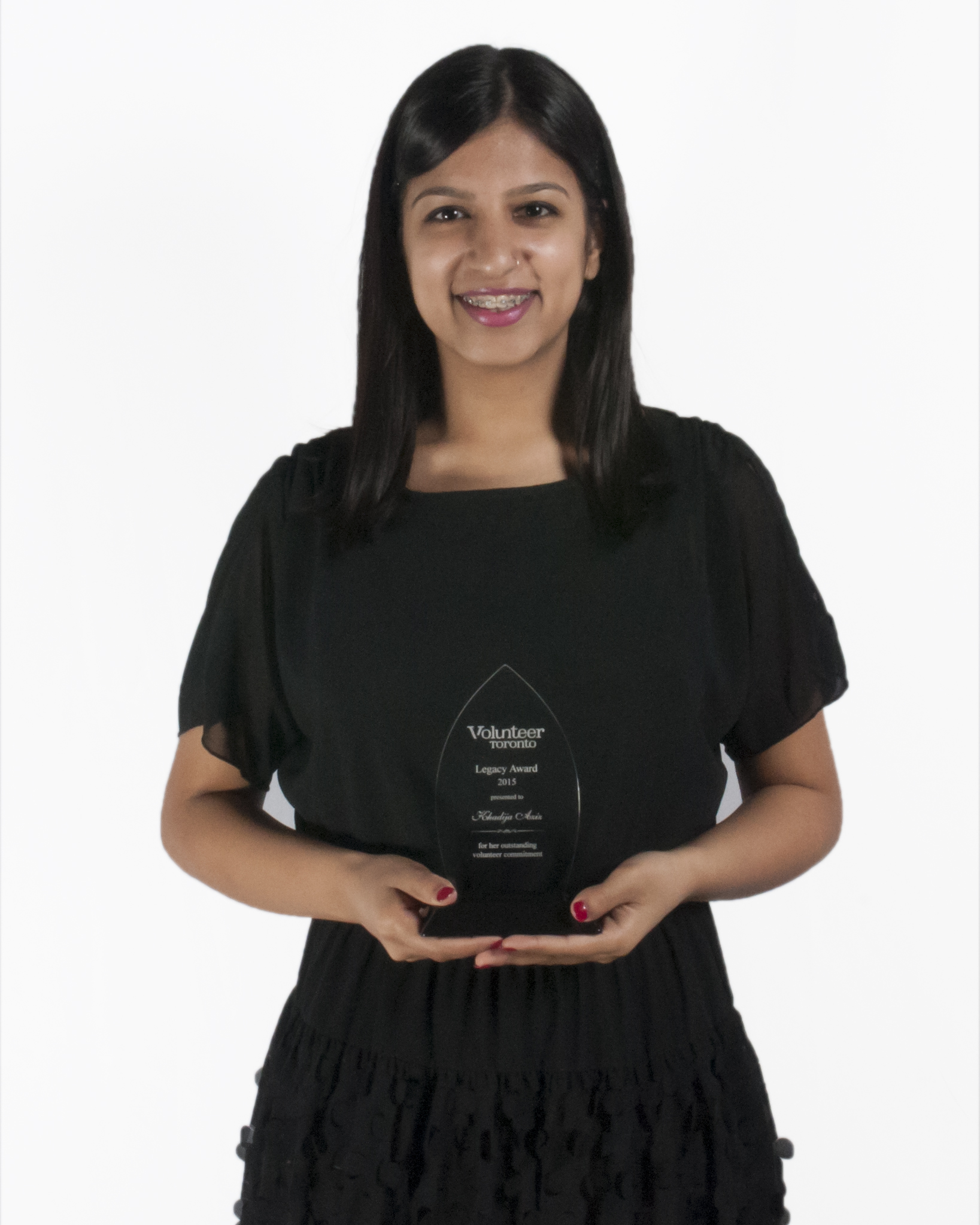 Photo of Khadija Aziz with Award