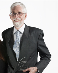 Photo of Simon Chamberlain with Award