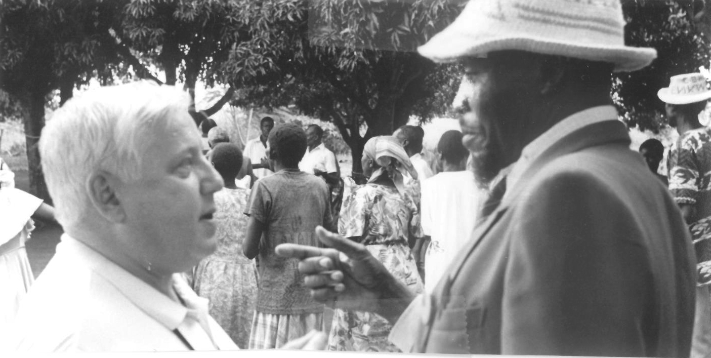 Colin Rainsbury talking to local village chief in Kenya