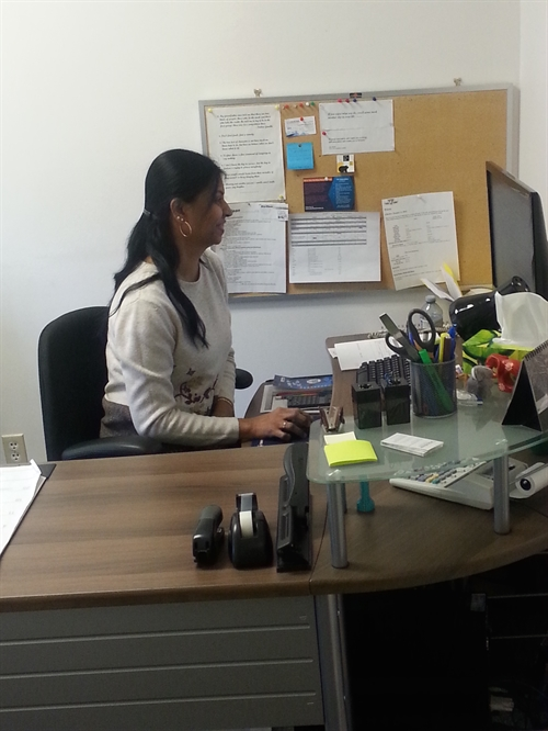 Nira at desk